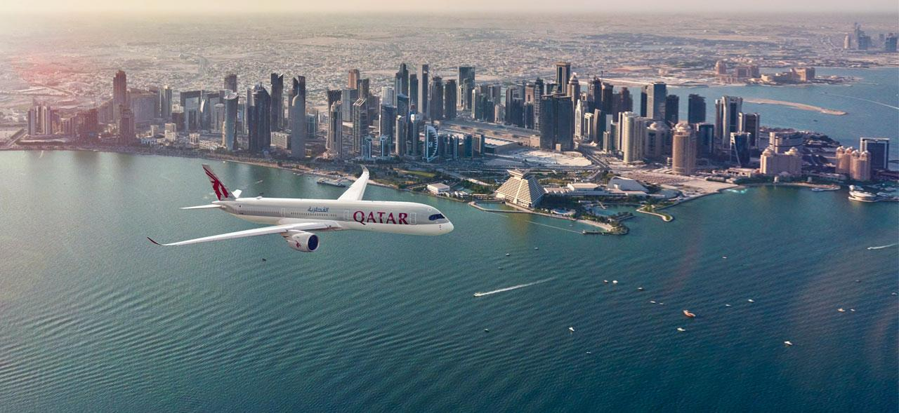 Plane flies over Doha